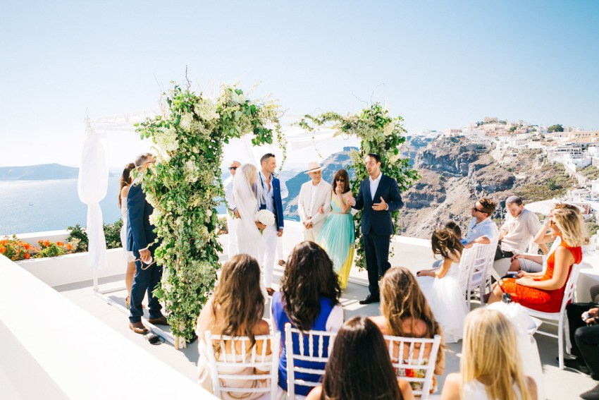 Jewish wedding ceremony view in Santorini caldera.