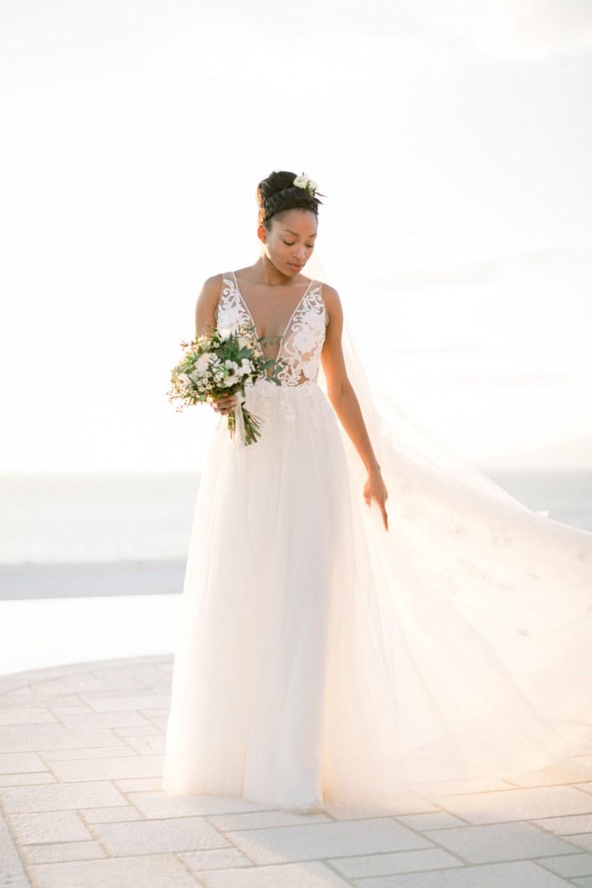 Stunning black bride at a villa wedding inspiration session by DeplanV in Loyal Villas Luxury, Mykonos, Greece.Stunning black bride at a villa wedding inspiration session by DeplanV in Loyal Villas Luxury, Mykonos, Greece.