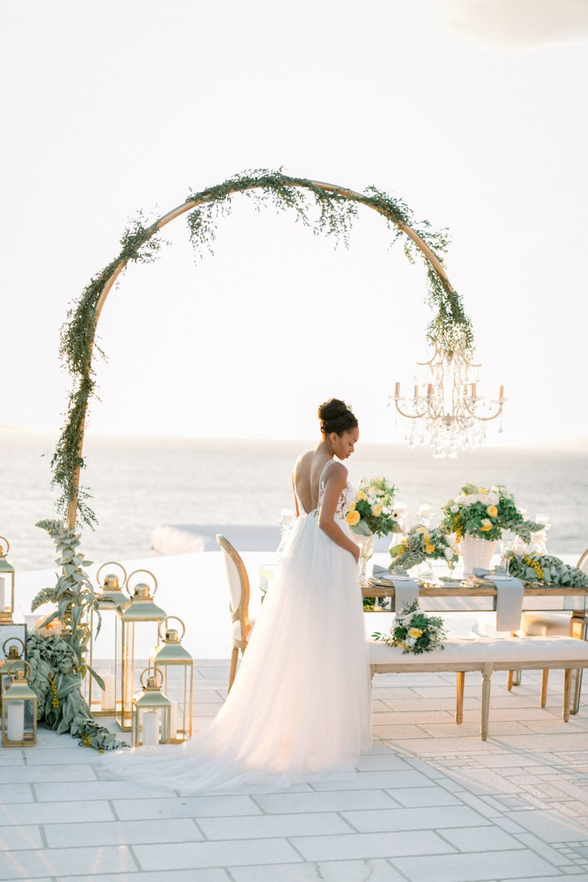 Luxury wedding reception and dinner setup with a bride by DeplanV for a white villa wedding inspiration session in Loyal Villas Luxury, Mykonos, Greece.