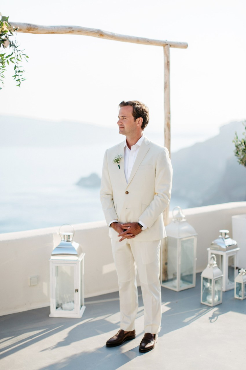 Stylish groom getting married in Canaves Suites Oia Santorini.