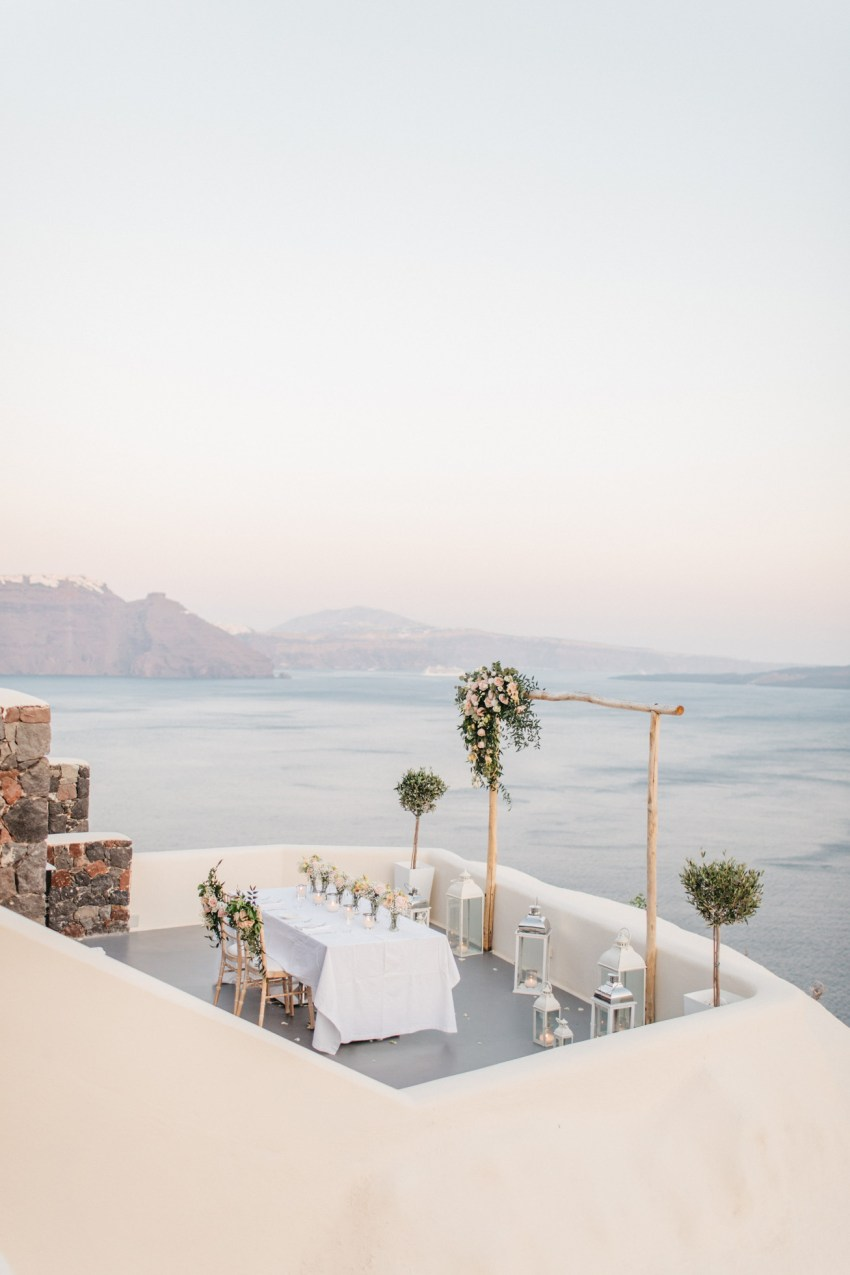 Beautiful wedding dinner setup in Canaves Suites Oia Santorini.