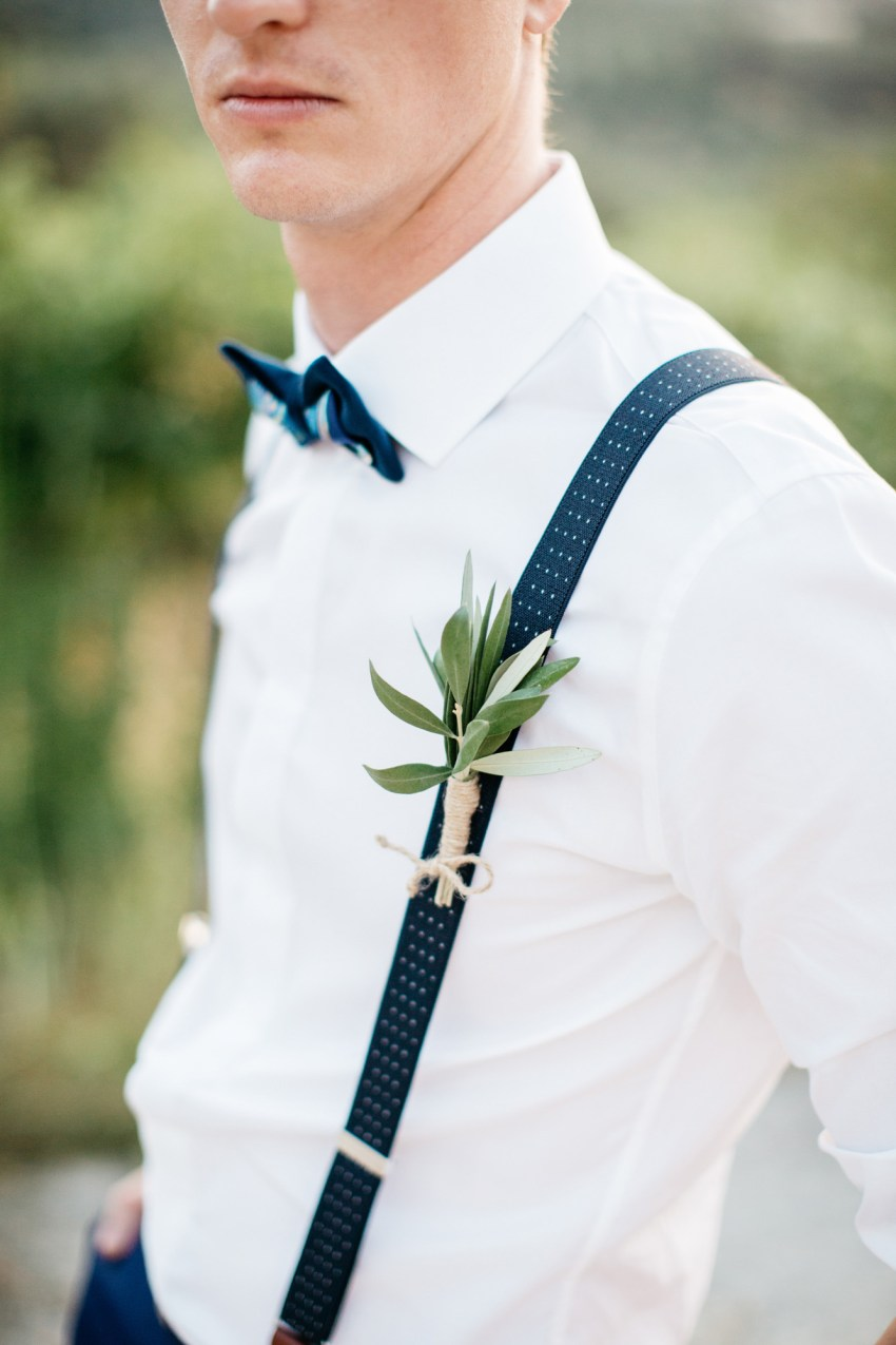 Stylish modern wedding groom at Grecotel Agreco Farm Crete Greece.