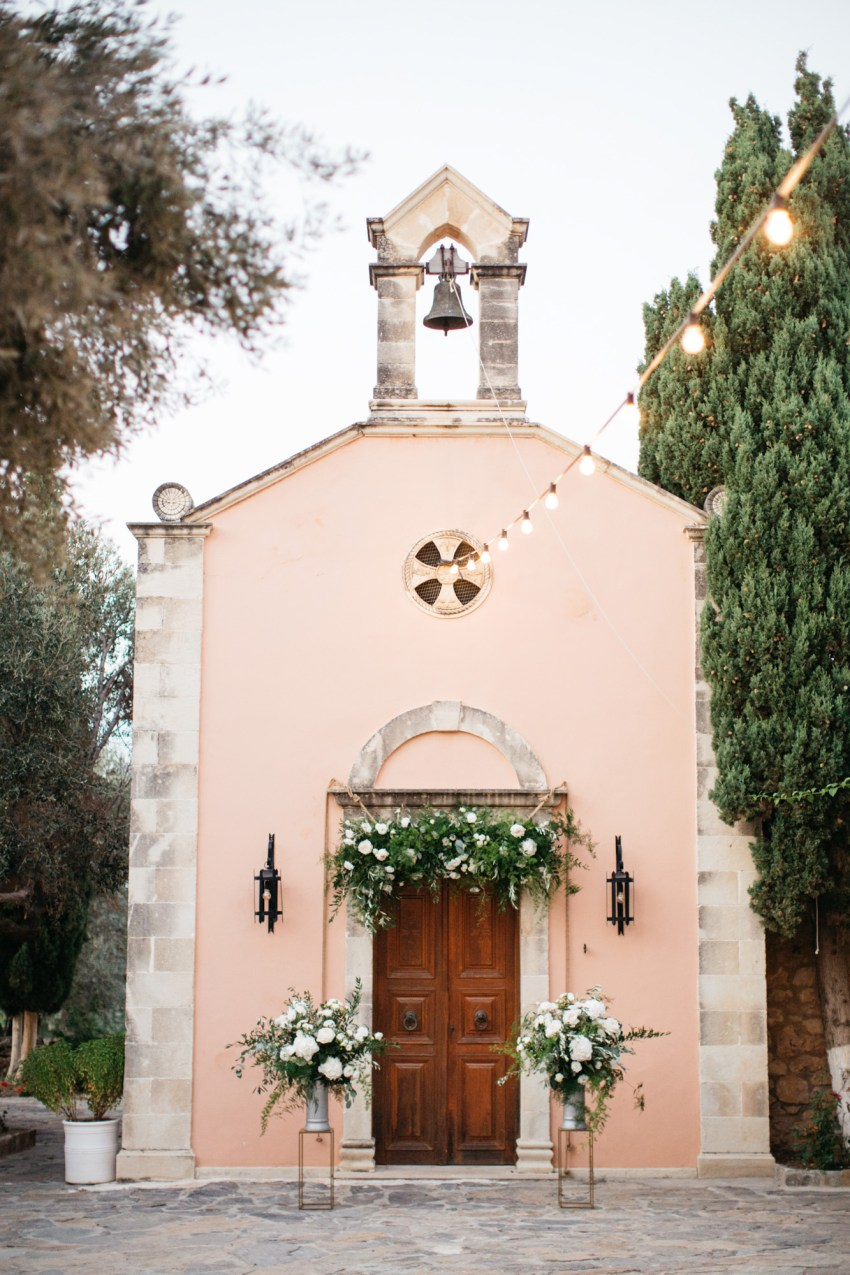 Wedding decorations and ceremony setup at St. Nicolas church at Grecotel Agreco Farm Rethymno Crete.