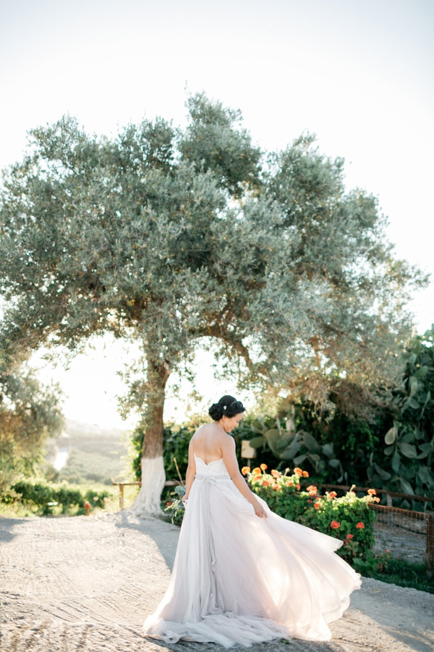 Elegant bride at her destination wedding in Agreco Farms, Grecotel, Crete, Greece.