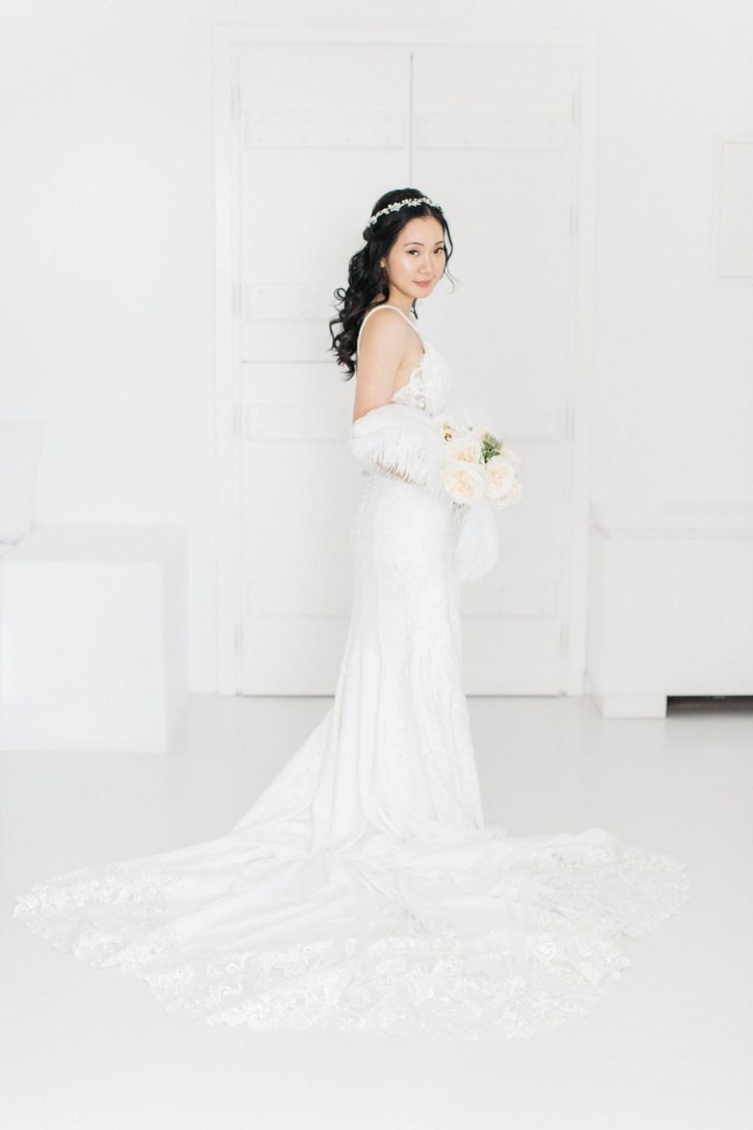Beautiful bride at her destination wedding in Aenaon Villas in Oia Santorini Greece.