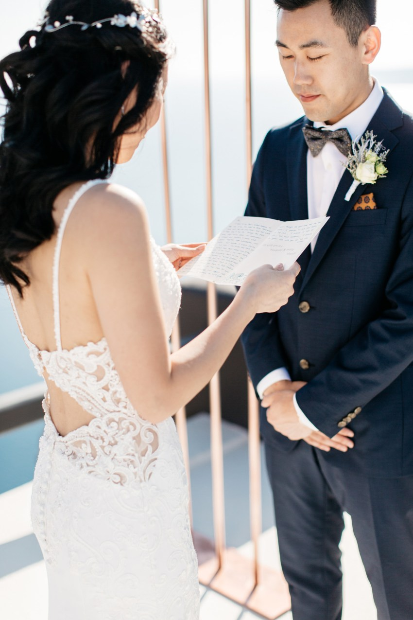 Destination wedding ceremony in Aenaon Villas in Oia Santorini Greece.