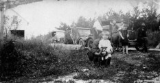 Elaine Treutel poses with the family dog in this ca. 1923 photo near Vesper, Wis. Directly behind her is older sister Ruby V. Treutel. Sitting on the bumper of the car is father Walter Treutel (1879-1948). The others are unidentified.