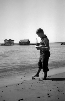 David D. Hanneman with his toe in the sand at Madeline Island, circa 1942.