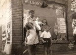 "Our newest ""Eye on the Past"" feature photo shows a charming little grocery store located about 1.5 miles west of Lake Michigan in Waukegan, Illinois. Wilson's Food Store was located at 1814 Grand Avenue, operated by my Dad's aunt and uncle, Nina (Treutel) Wilson and Lawrence Wilson. Nina was a younger sister of my Grandmother Ruby (Treutel) Hanneman. Read more about it here: http://wp.me/p4FxQb-e0"