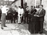Reporter Joe Hanneman (left) takes notes as Gov. Tommy G. Thompson holds a press event in Racine, circa 1988.