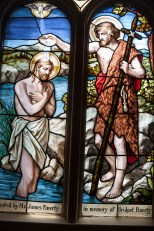 Jesus' baptism stained glass window.