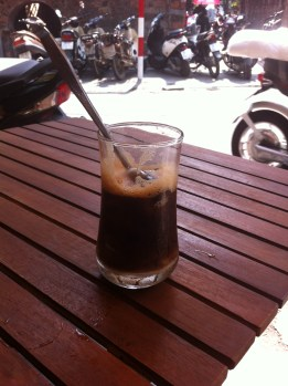 cà phê sữa đá (iced white coffee) at a street cafe in Ha Noi, Vietnam