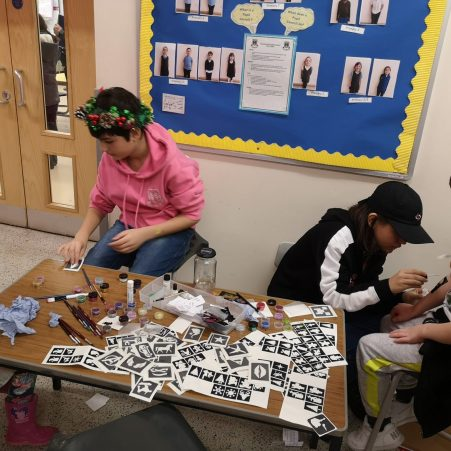 Glitter tattoos - being applied by former pupils!