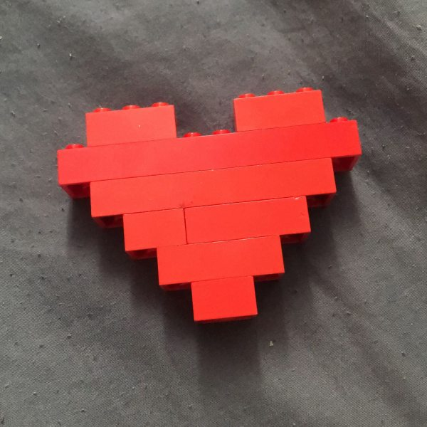 Heart made of red Lego bricks