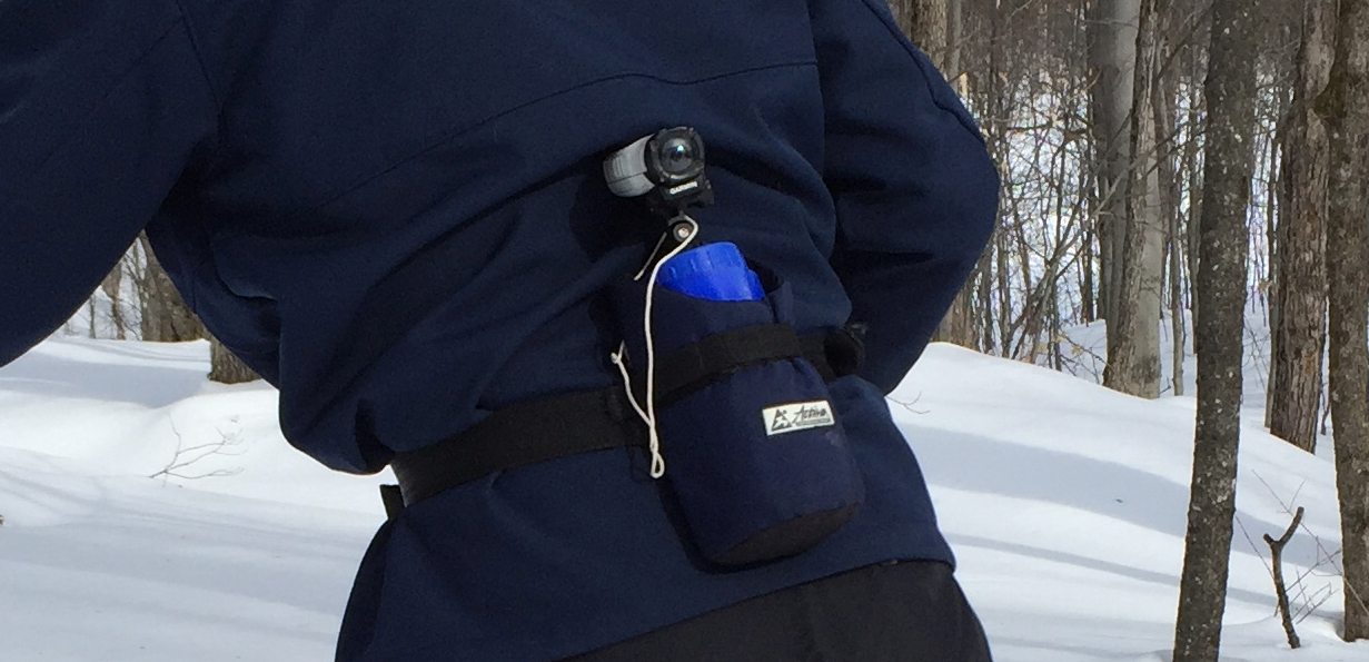 A close up of our concoction. The rope keeps the camera connected to the belt.