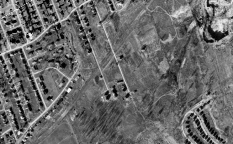 The left tow north south line is Ridell Ave, the right one is Maitland in 1958. This is where the overpass is, covering a size of Parliament Hill. you can clearly see where the Queensway will go.