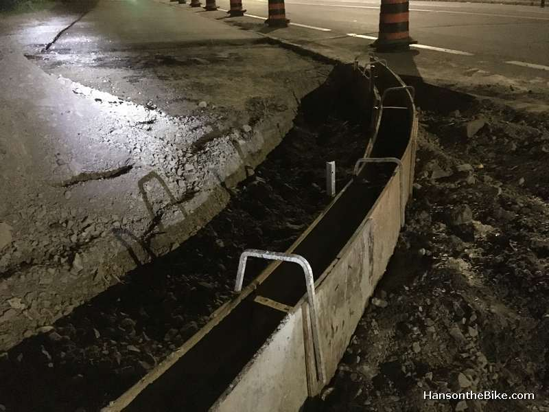 Curbs are made by hand. In other countries you often see precast concrete curbs