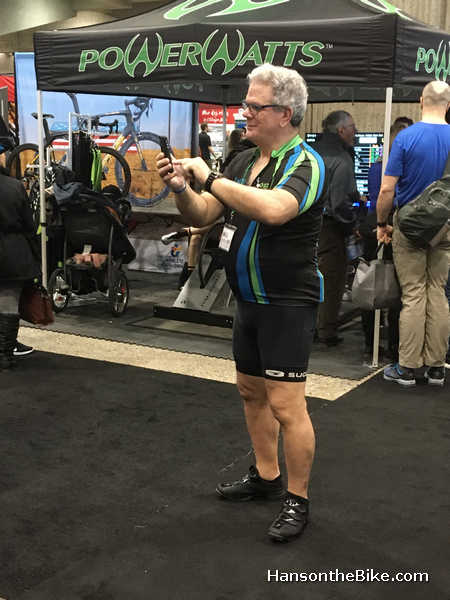 man in Spandex shorts taking photo at Montreal Bicycle show