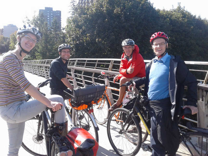 group of cyclists on bridge