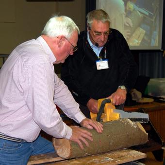 Alan & Bob cutting up a log