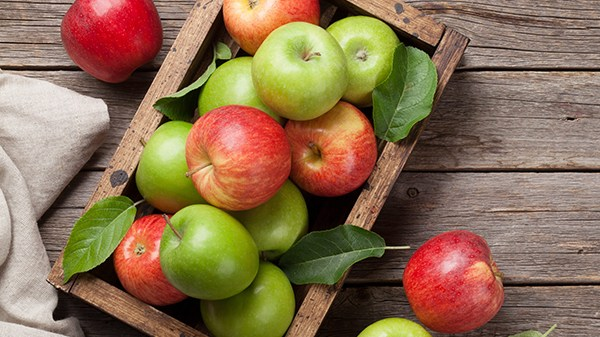 Ripe green and red apples in wooden box. Top view with space for your text; Shutterstock ID 1104559169; job: Job (RD)