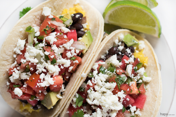 These vegetarian Black Bean Tacos are healthy, filling, and packed with a ton of flavor! Go ahead... have another one.