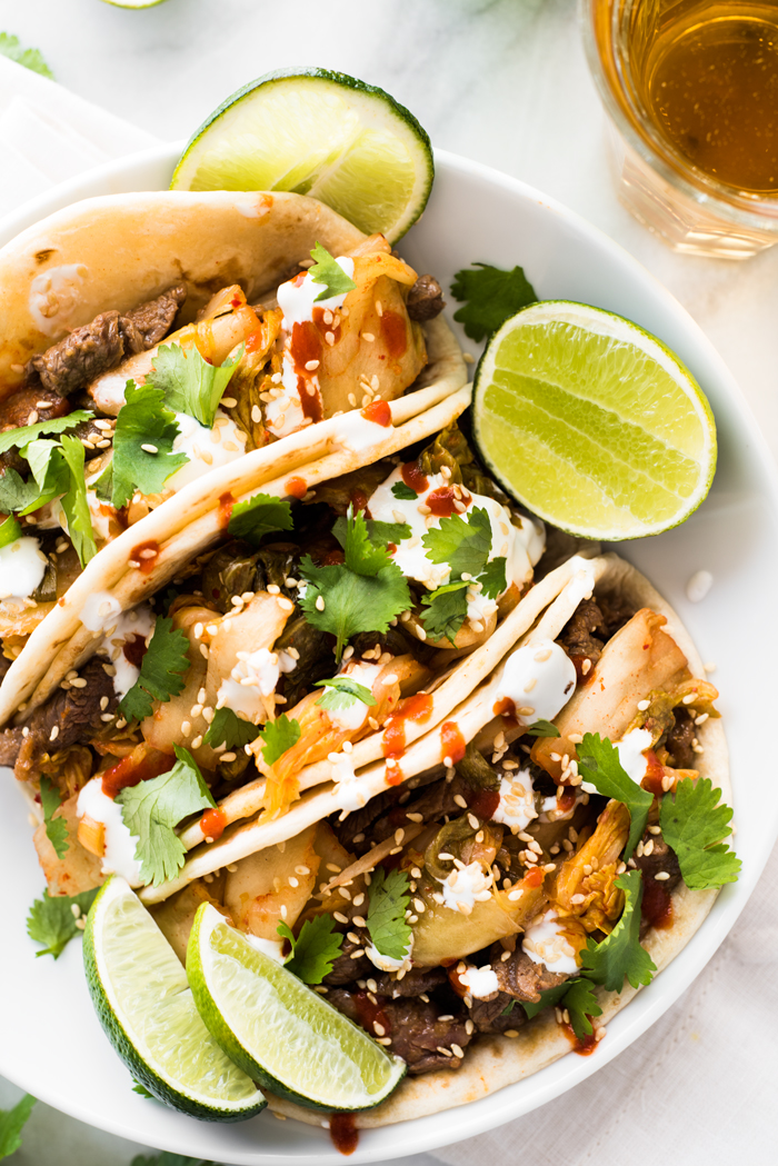 A full flavor experience - umami rich bulgogi beef, spicy kimchi, cool sour cream, and smoky Sriracha. You'll be devouring these Korean tacos!