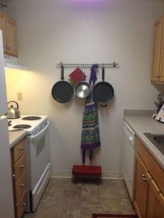 Use a pot rack to hang anything you need handy while cooking. This one is mine. [re-pin]