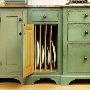 Store pans, serving dishes, or cutting boards vertically to make the best use of space [source]