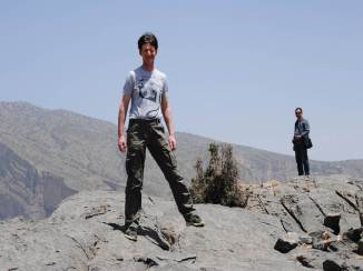 Florian on top of the mountain, with Achmed in the background.