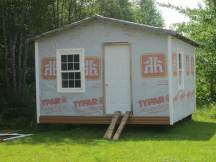 The building before the siding. One day it will be a mini-gym.