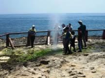 Tourists enjoying the blowhole at Mughsayl Beach