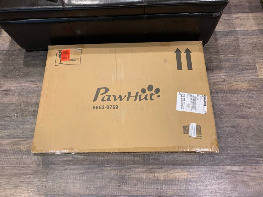 The compact box in which the Pawhut dog grooming table is shipped.