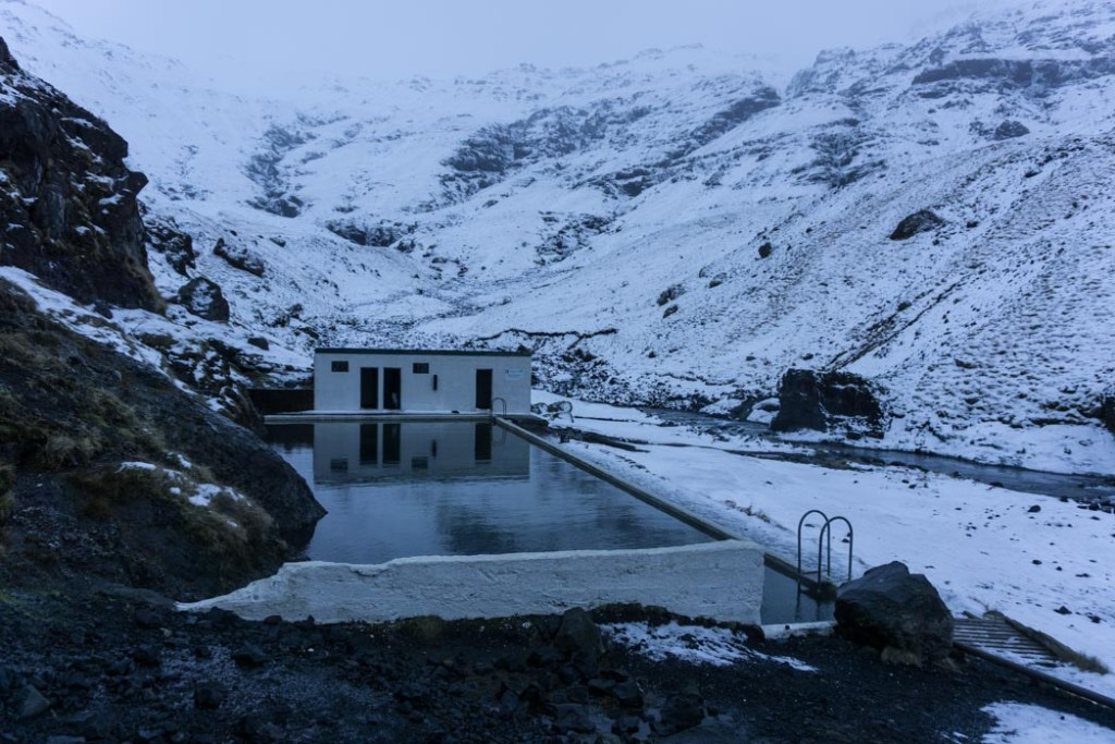 Geothermal swimming pool Seljavallalaug in winter in Iceland. A winter week in Iceland. Iceland in January. 35 Photos that will make you want to go to Iceland in winter.