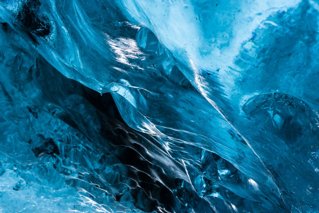 Close-up of the blue ice formations in an ice cave in Iceland .The Ultimate Guide to Ice Caves in Iceland: Everything you ever needed to know about visiting ice caves in Iceland. Find out how to go INSIDE the Crystal Cave glacier ice cave to see the blue ice.