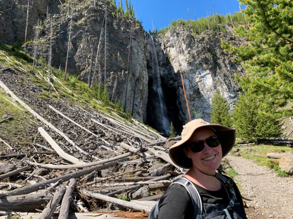 A hiker at Fairy Falls in Yellowstone National Park
