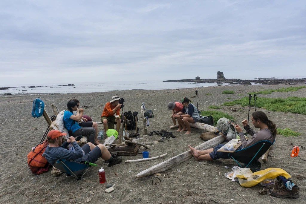 Hikers eating lunch at Bonilla Point on the West Coast Trail
