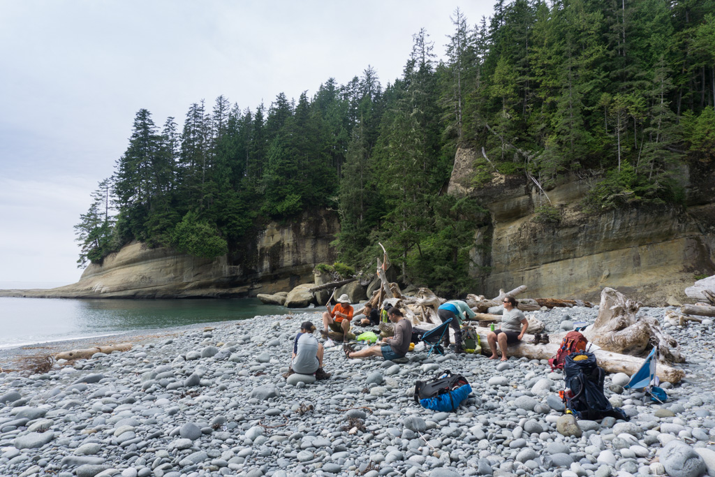 Hikers taking a break at Cullite Cove on the West Coast Trail
