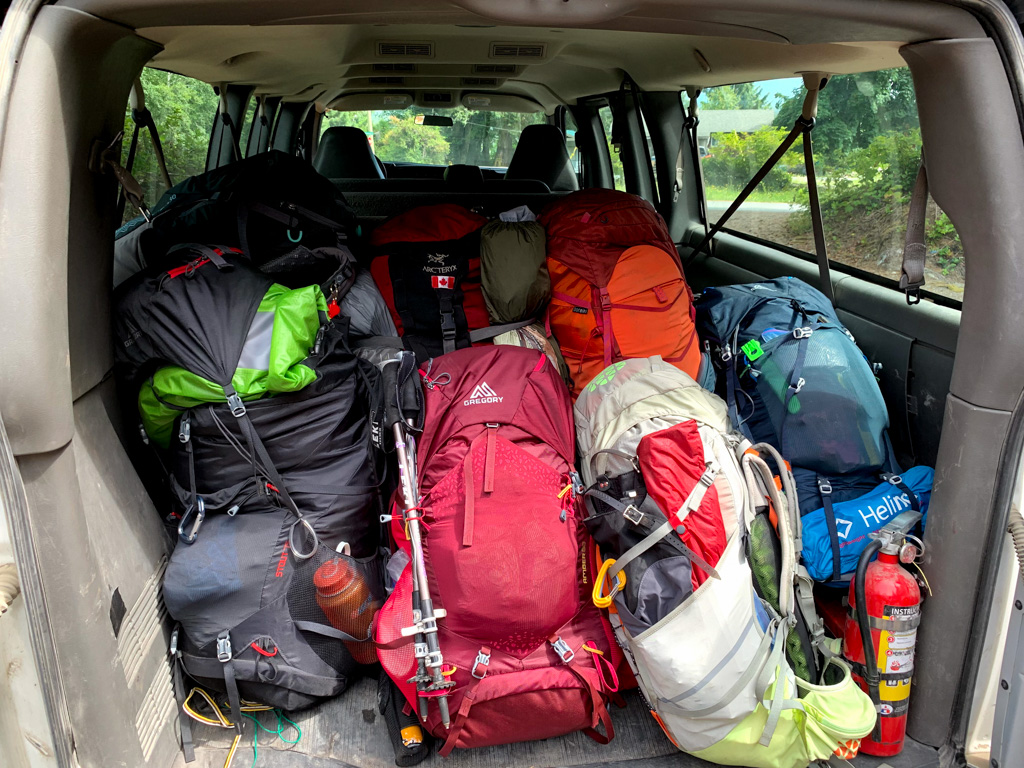 Backpacks in the back of a shuttle ready to go to the West Coast Trail. West Coast Trail Transportation. How to get to the West Coast Trail