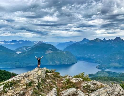 Hiker on Tin Hat Mountain the Sunshine Coast Trail in British Columbia, Canada.