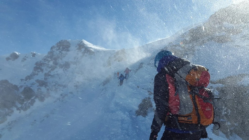 Mountaineers ascend a snowy peak in windy conditions. There are lots of great women's adventure films about mountaineering.