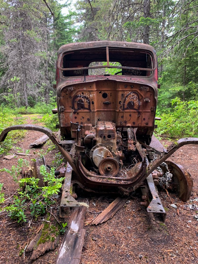Front view of an abandoned old truck in the forest near Whistler, BC