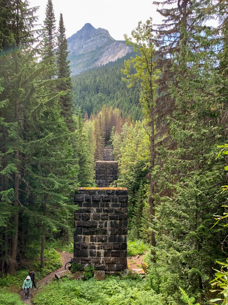 Old railway support pillars on the Loop Brook trail in Glacier National Park of Canada.