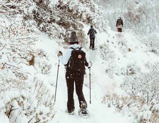 Snowshoers on a snow trail - You need this list of the best gifts for snowshoers
