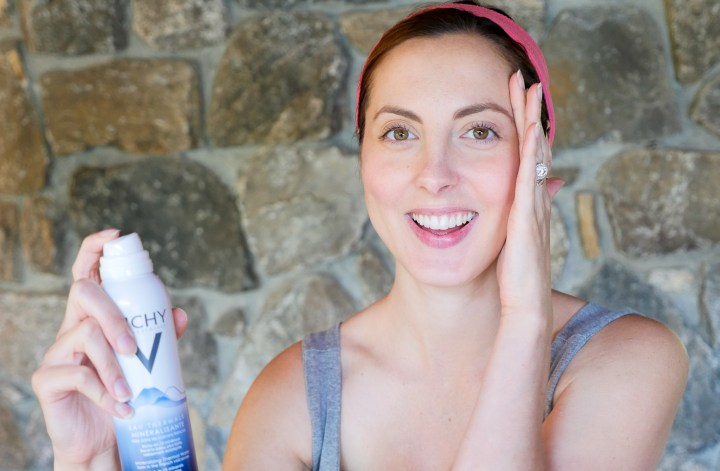 Eva Amurri Martino of lifestyle blog Happily Eva After spritzing her face with a mineralizing water to keep skin healthy