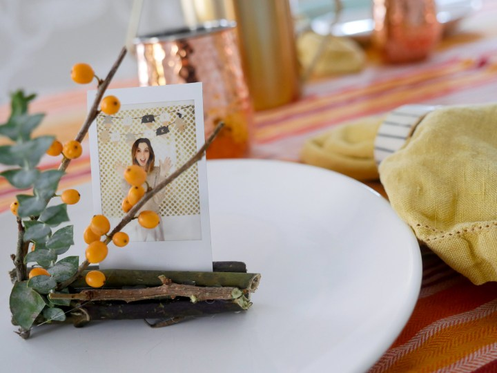 Eva Amurri Martino's fresh and festive Holiday Photo Frame Place card settings using the Instax mini 70