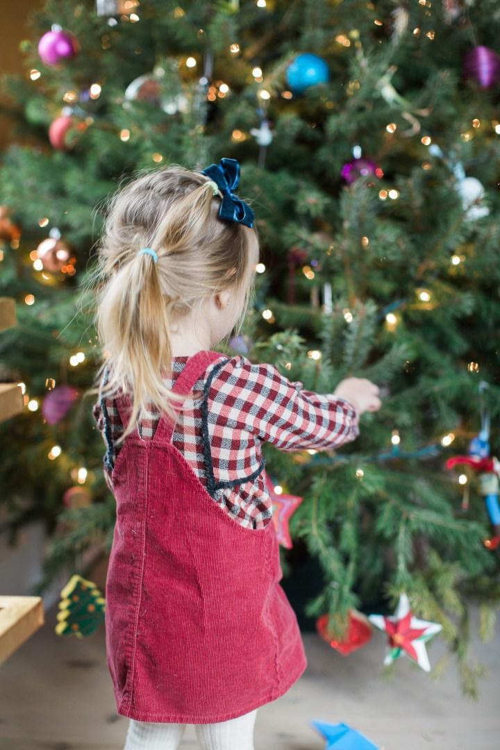 Marlowe Martino decorates the Christmas tree