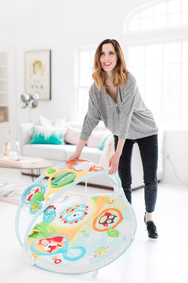Eva Amurri Martino of lifestyle and Motherhood blog Happily Eva After sets up a play area in her home studio