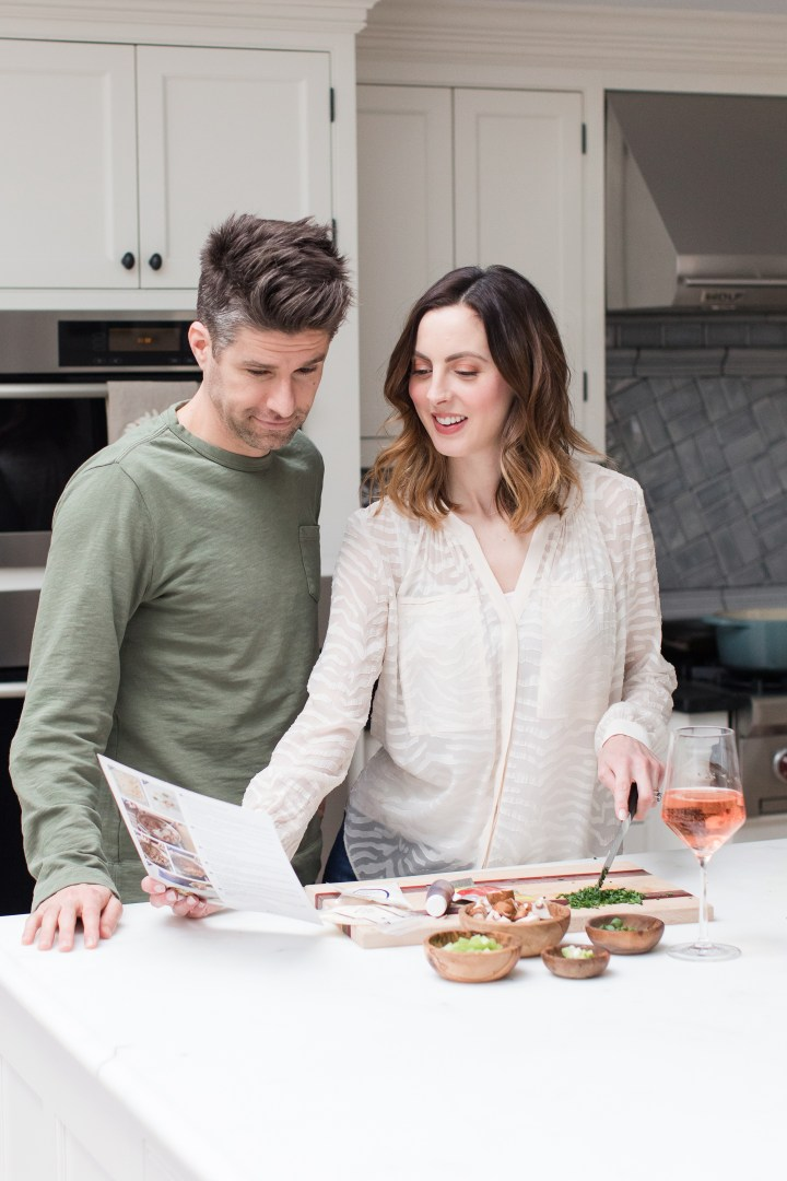 Eva Amurri Martino and Kyle Martino cook dinner together in the kitchen of their Connecticut home