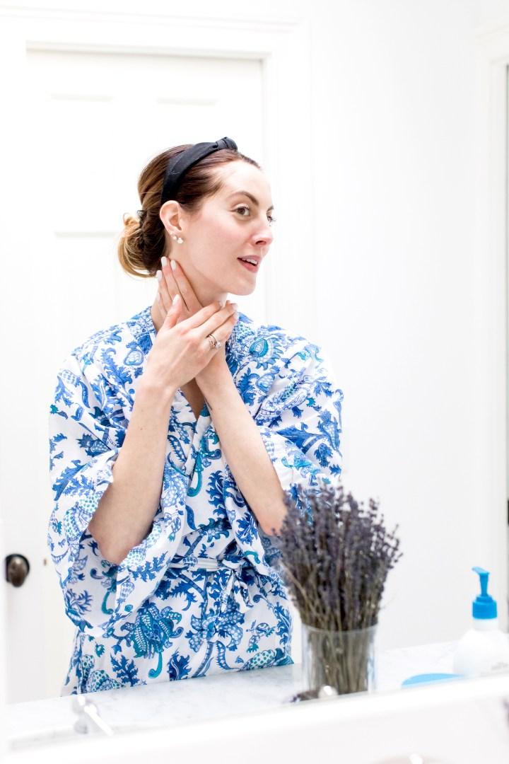 Eva Amurri Martino applies Gentle Basics night cream to her neck and decollete